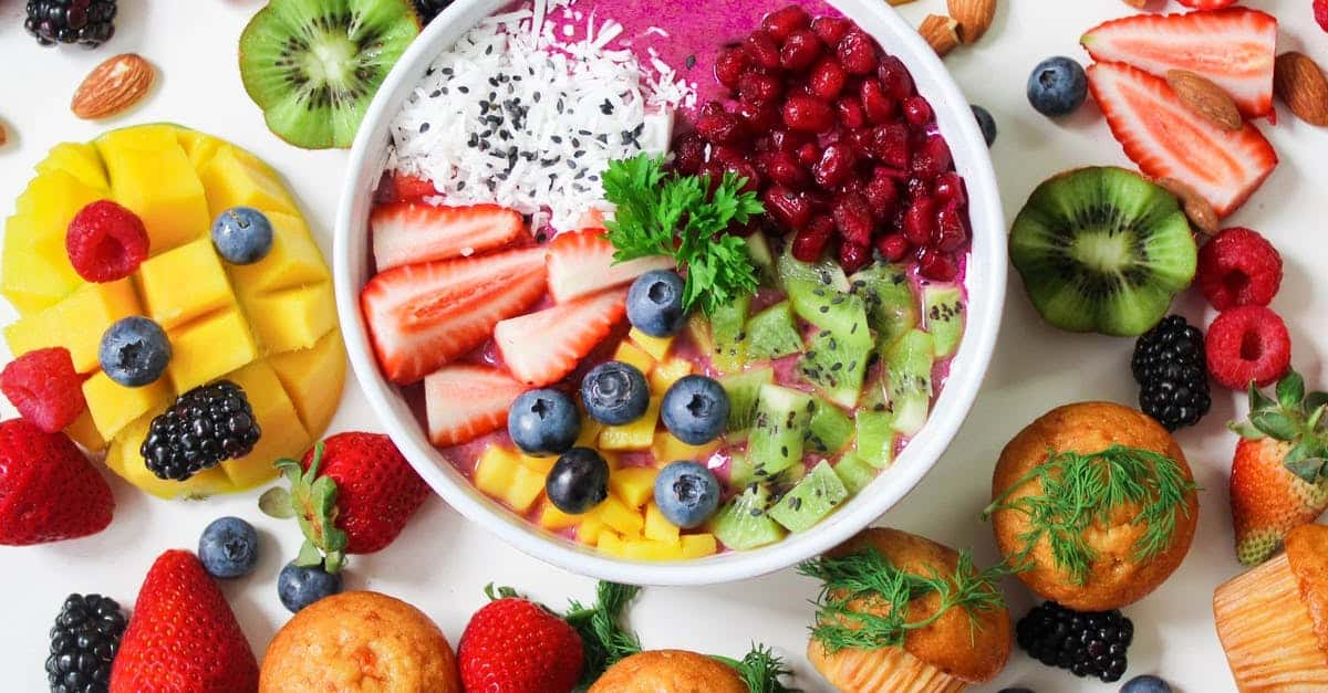 A plate is filled with fresh fruit and vegetables